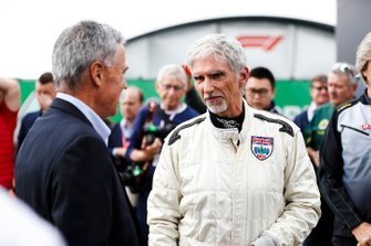 Damon Hill talks to Chase Carey, Chairman, Formula 1, after driving the Lotus 49 driven to the 1968 title by his father Graham Hill