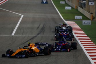 Lando Norris, McLaren MCL34, leads Alexander Albon, Toro Rosso STR14, Daniil Kvyat, Toro Rosso STR14, and Antonio Giovinazzi, Alfa Romeo Racing C38