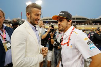 David Beckham talks with Fernando Alonso on the grid