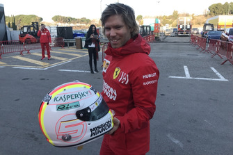 Antti Kontsas with Sebastian Vettel's helmet