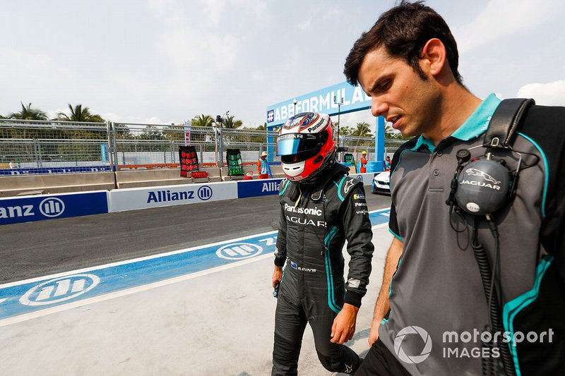 Mitch Evans, Panasonic Jaguar Racing, Jaguar I-Type 3, walks with a team member.