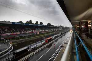 A wet pitlane and pit straight grandstands