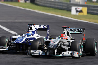 Michael Schumacher, Mercedes GP MGP W01 and Rubens Barrichello, Williams FW32 battle for position