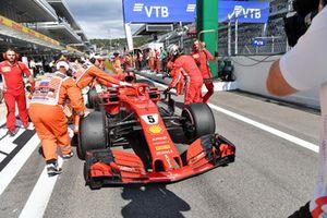 Sebastian Vettel, Ferrari pushes his car back in the pit lane