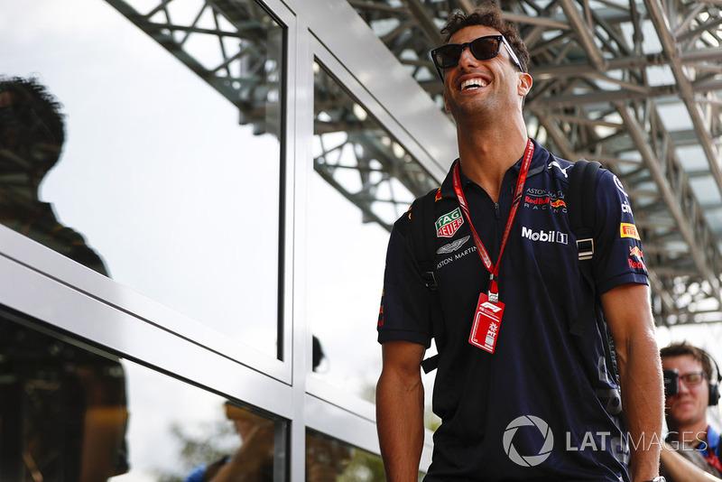 Daniel Ricciardo, Red Bull Racing, arrives in the paddock in good spirits
