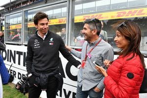 Toto Wolff, Mercedes AMG F1 Director of Motorsport with the Father of Esteban Ocon, Racing Point Force India F1 Team on the grid