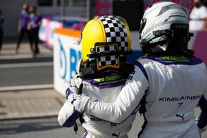 Irina Sidorkova, 2nd position, and Emma Kimilainen, 3rd position, congratulate each other in Parc Ferme