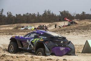 The damaged cars of Cristina Gutierrez, Sebastien Loeb, X44, and Mikaela Ahlin-Kottulinsky, Kevin Hansen, JBXE Extreme-E Team, in the final