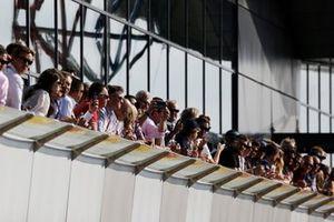 Fans watch from a terrace
