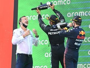 Lewis Hamilton, Mercedes, 1st position, pours Champagne over the Mercedes trophy delegate