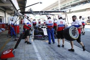The Haas team practise a pit stop on the Mick Schumacher Haas VF-21