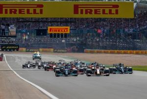 Max Verstappen, Red Bull Racing RB16B, and Lewis Hamilton, Mercedes W12, lead the field away at the start