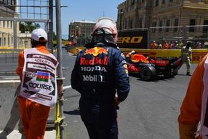 Marshals assist Max Verstappen, Red Bull Racing RB16B, after his crash in FP3