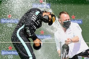 Lewis Hamilton, Mercedes, 1st position, and the Mercedes trophy delegate celebrate with Champagne
