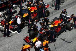 Max Verstappen, Red Bull Racing RB16B, passes Sergio Perez, Red Bull Racing RB16B, on the grid