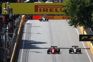 Carlos Sainz Jr., Ferrari SF21, Kimi Raikkonen, Alfa Romeo Racing C41, and Antonio Giovinazzi, Alfa Romeo Racing C41
