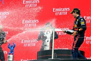 Gianpiero Lambiase, Race Engineer, Red Bull Racing, and Sergio Perez, Red Bull Racing, 3rd position, spray Max Verstappen, Red Bull Racing, 1st position, with Champagne on the podium