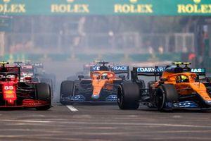 Lando Norris, McLaren MCL35M, Carlos Sainz Jr., Ferrari SF21, Daniel Ricciardo, McLaren MCL35M, at the restart
