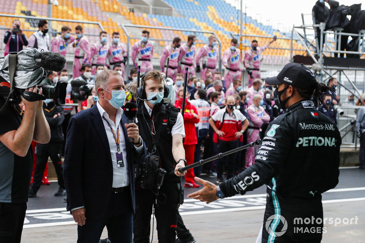 Lewis Hamilton, Mercedes-AMG F1, 1st position, is interviewed by Martin Brundle, Sky TV, after securing his seventh world drivers championship title
