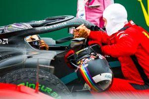 Race winner Lewis Hamilton, Mercedes F1 W11 with third place Sebastian Vettel, Ferrari