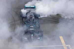 Lewis Hamilton, Mercedes-AMG F1, 3rd position, performs celebratory donuts after the race