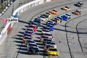 Martin Truex Jr., Joe Gibbs Racing, Toyota Supra STANLEY and Riley Herbst, Stewart-Haas Racing, Ford Mustang Monster Energy