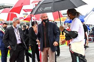 Chase Carey and Greg Maffei, CEO, Liberty Media Corporation, with Lewis Hamilton, Mercedes