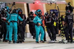 The Mercedes pit crew clear up after a stop