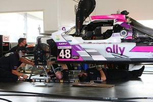 #48 Action Express Racing Cadillac DPi is being attended to in the pit area