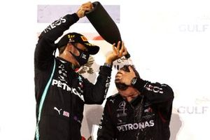 Lewis Hamilton, Mercedes-AMG F1, 1st position, celebrates by pouring Champagne over the Mercedes trophy deleagte on the podium