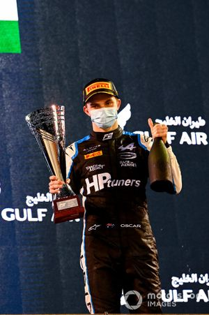 Oscar Piastri, Prema Racing, 1st position, on the podium with his trophy