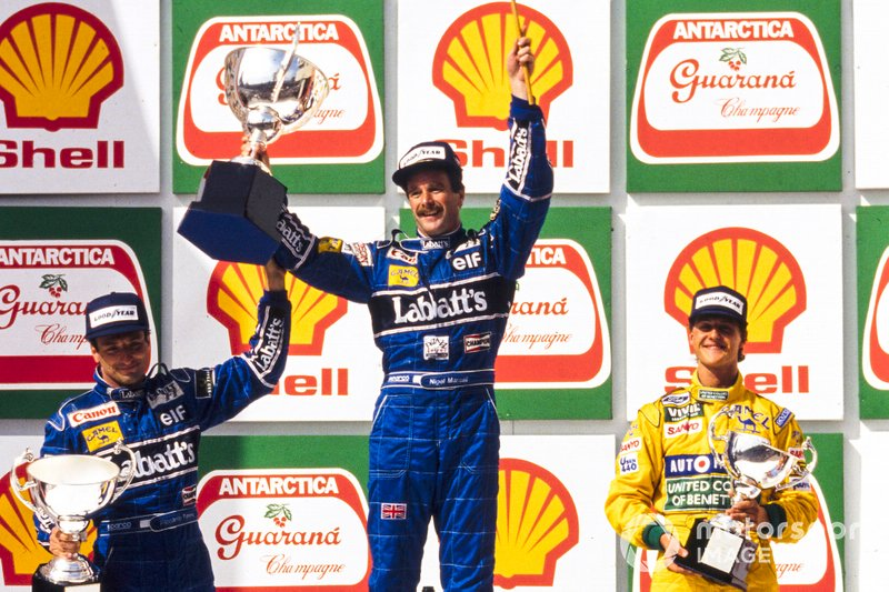 Podium: second place Riccardo Patrese, Willams, Race winner Nigel Mansell, Williams, third place Michael Schumacher, Benetton