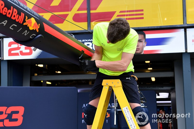 A member of the Red Bull team packs away equipment in the pitlane
