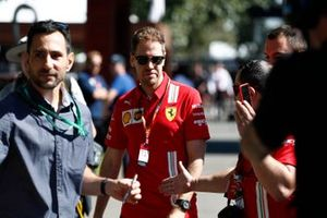 Sebastian Vettel, Ferrari, arrives at the track