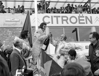 Winner Emerson Fittipaldi, Lotus, 3rd placed Denny Hulme, McLaren, 2nd placed Francois Cevert, Tyrrell on the podium