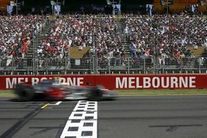 Lewis Hamilton, McLaren MP4-22 Mercedes, 3rd Position, crosses the line to take his first podium in his debut F1 race