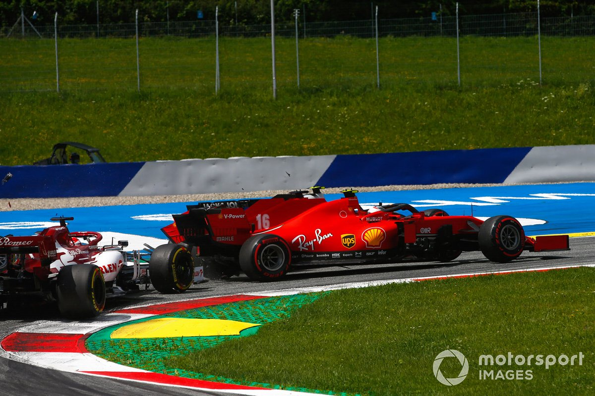 Charles Leclerc, Ferrari SF1000, and Sebastian Vettel, Ferrari SF1000 collide on the opening lap