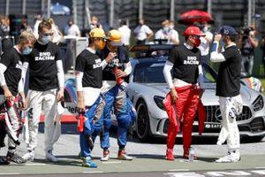 Kevin Magnussen, Haas F1, Daniil Kvyat, AlphaTauri, Lando Norris, McLaren, Carlos Sainz Jr., McLaren, Charles Leclerc, Ferrari, e Pierre Gasly, AlphaTauri, in griglia prima della partenza