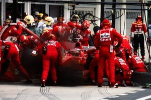 Michael Schumacher, Ferrari F300, makes a pitstop