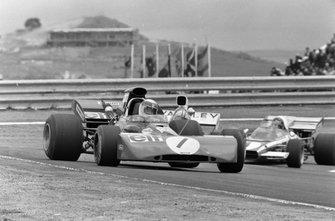 Jackie Stewart, Tyrrell 003 Ford leads Denny Hulme, McLaren M19A Ford and Jacky Ickx, Ferrari 312B2