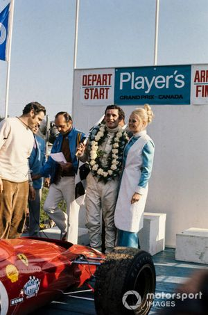Winner Jacky Ickx at the podium with his Ferrari 312B