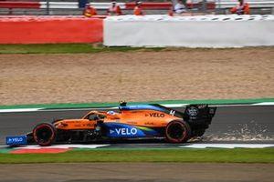 Sparks under the car of Lando Norris, McLaren MCL35