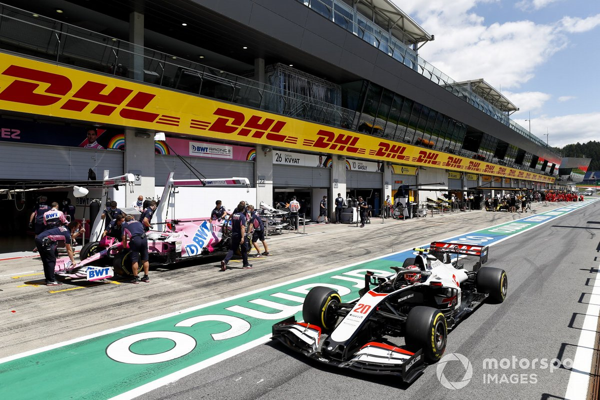 Kevin Magnussen, Haas VF-20 and Sergio Perez, Racing Point RP20