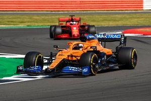 Carlos Sainz Jr., McLaren MCL35, Sebastian Vettel, Ferrari SF1000