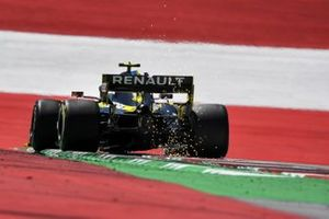 Sparks kick up from the car of Esteban Ocon, Renault F1 Team R.S.20