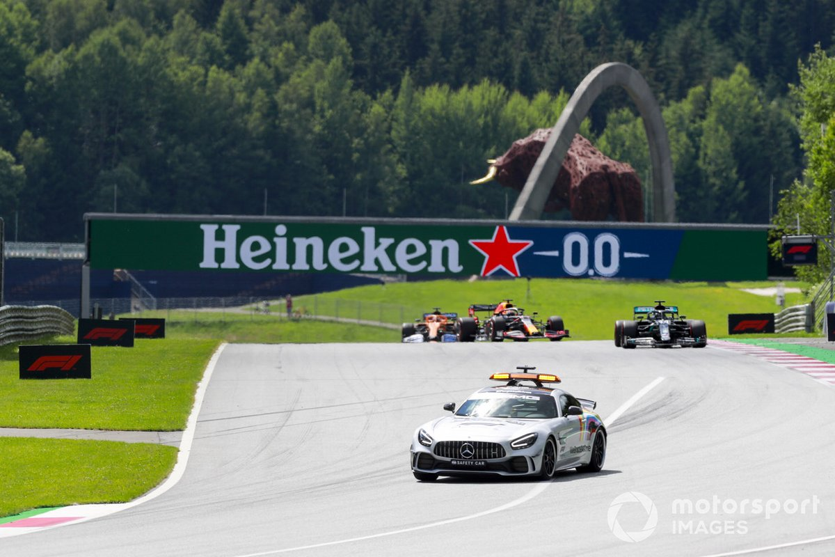 The Safety Car leads Lewis Hamilton, Mercedes F1 W11 EQ Performance, Max Verstappen, Red Bull Racing RB16, and Carlos Sainz Jr., McLaren MCL35