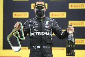 Valtteri Bottas, Mercedes-AMG Petronas F1 celebrates on the podium with the champagne and the trophy