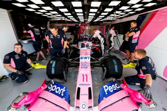 Mechanics in the garage with the car of Sergio Perez, Racing Point RP19