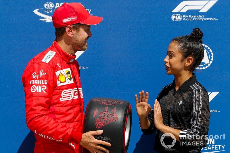 Sebastian Vettel, Ferrari, is presented with his Pirelli Pole Position Award by actress Liza Koshy