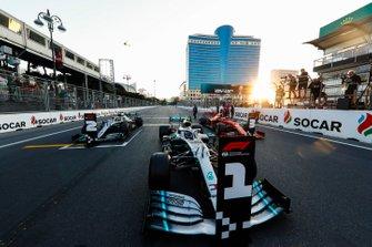 Polesitter Valtteri Bottas, Mercedes AMG W10, Lewis Hamilton, Mercedes AMG F1 W10 and Sebastian Vettel, Ferrari SF90 in Parc Ferme